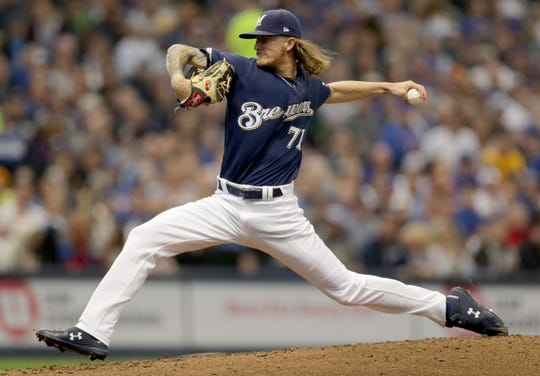 Josh Hader pitches in the seventh, finishing the game with a 2 2/3-inning save.