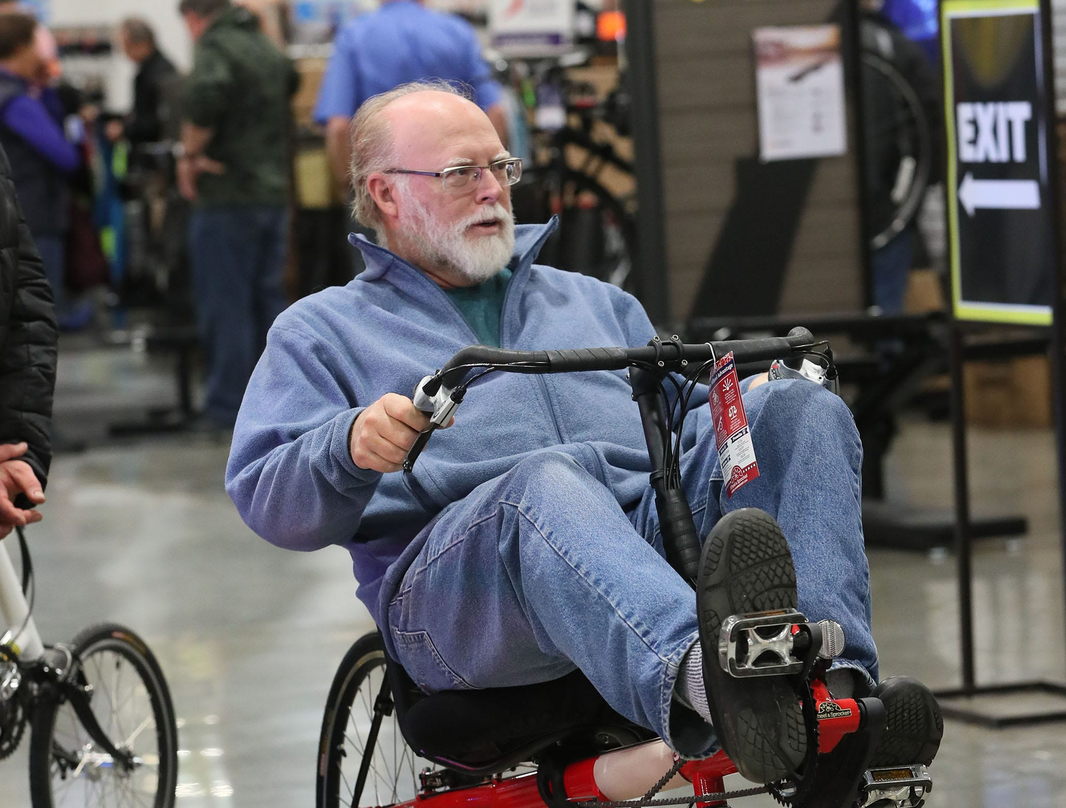 Kevin Andrist of Caledonia tests out a recumbent bike mounted on a trainer.