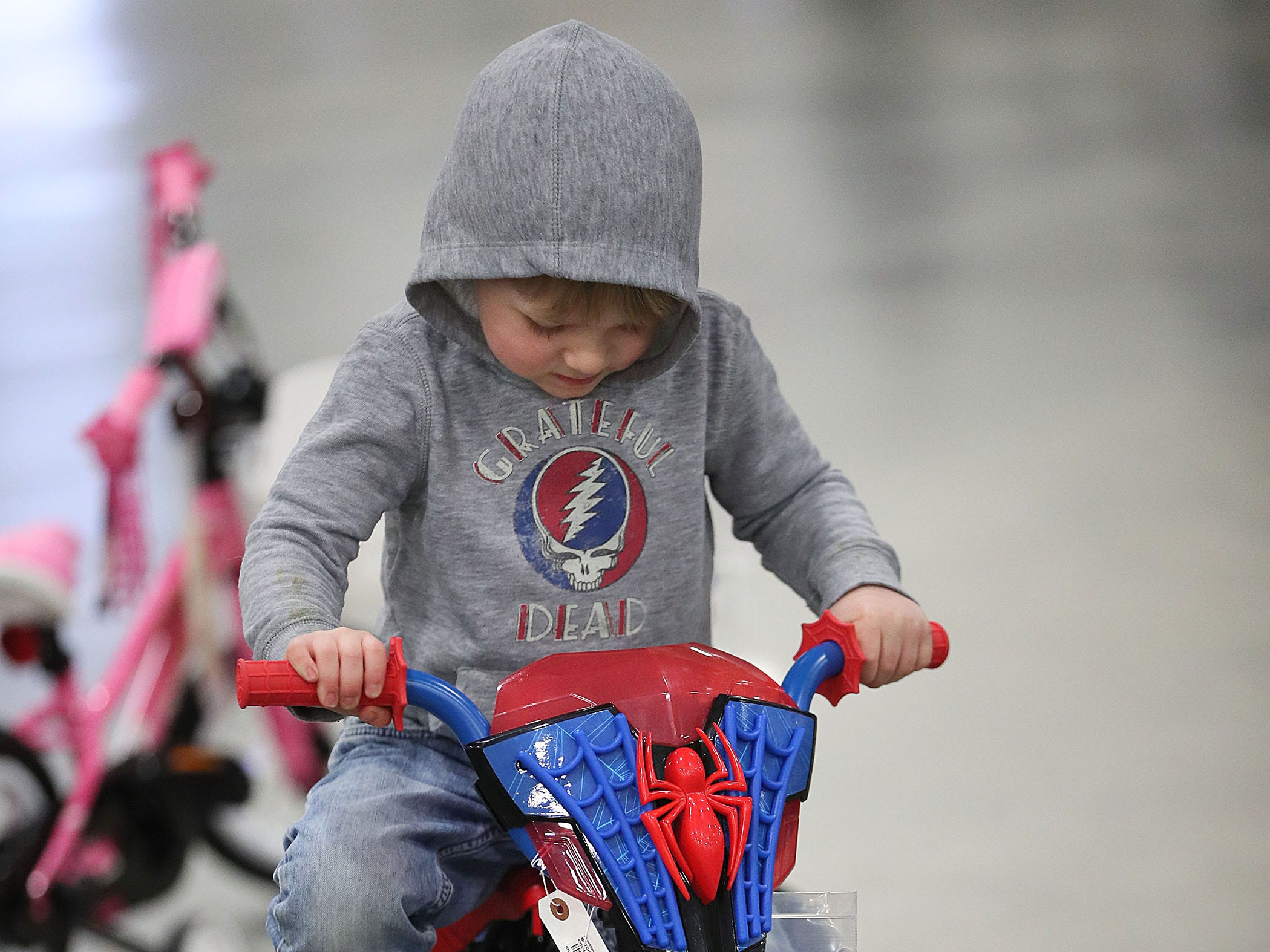 Louis Joy, 3, of Wauwatosa tests out a Spider-Man-themed bike.