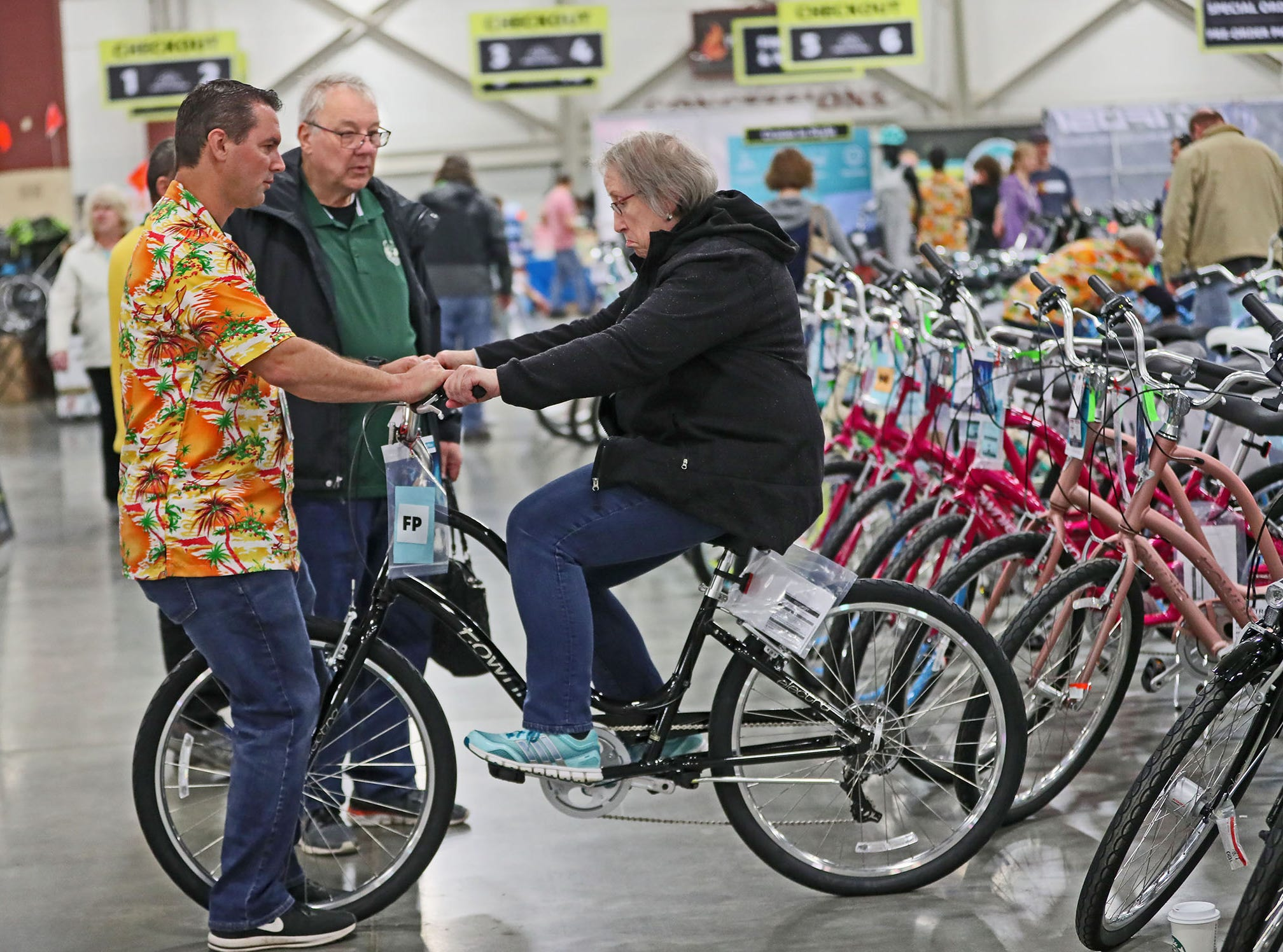 Everything bike was on display and for sale at Wheel & Sprocket's 35th annual Bike Expo Sale at the Wisconsin Exposition Center at State Fair Park.  Travis Vance of the Electra Bicycle Company helps Susan Weyer of Waukesha get the feel for one of the comapny's bikes. Her husband Barry Weyer (center) looks on.