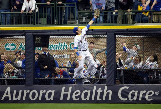 Christian Yelich is unable to catch a ball hit by Chicago's Jason Heyward during the second inning Saturday. Heyward had two home runs in the game.