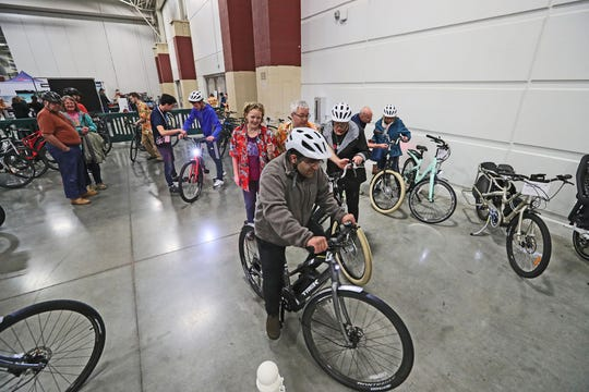 People take off on a test ride on the eBike Superstore Test Track, where riders could see what it is like riding a bike with an electric motor assist.