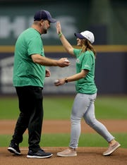 Lenny Zwieg greets Emily Nowak of Marathon before they throw out the first pitch.