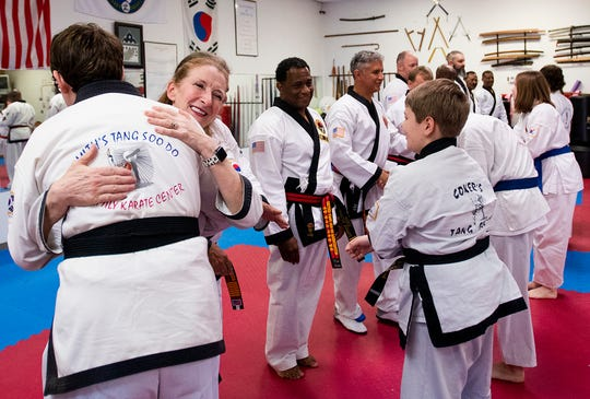 Master Carole Smith hugs her students after she gets her Master promotion as Tang Soo Do masters from around the country receive promotions during a ceremony at Family Karate Center in Montgomery, Ala., on Sunday April 7, 2019.