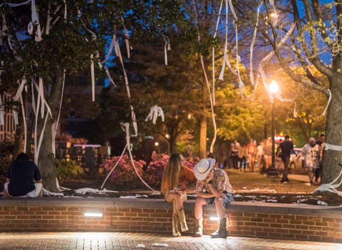 Auburn fans react to the basketball team's Final Four loss against Virginia at Toomer's Corner in Auburn, Ala., on Saturday, April 6, 2019.