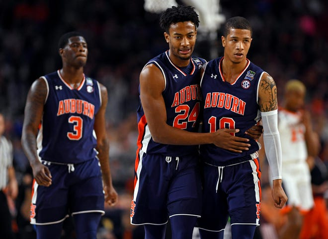 Auburn forward Anfernee McLemore (24) and guard Samir Doughty (10) react during a loss to Virginia in the Final Four on April 6, 2019, in Minneapolis.