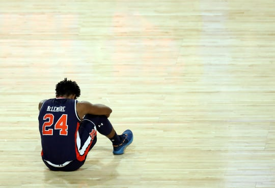 Auburn Tigers forward Anfernee McLemore (24) reacts after being defeated by the Virginia Cavaliers in the semifinals of the 2019 men's Final Four at US Bank Stadium.
