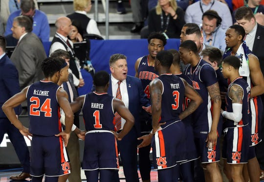 Auburn head coach Bruce Pearl speaks with his team during a timeout against Virginia in the Final Four at US Bank Stadium on April 6, 2019, in Minneapolis.