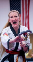 Master Carole Smith does a demonstration as Tang Soo Do masters from around the country receive their promotions during a ceremony at Family Karate Center in Montgomery, Ala., on Sunday April 7, 2019.
