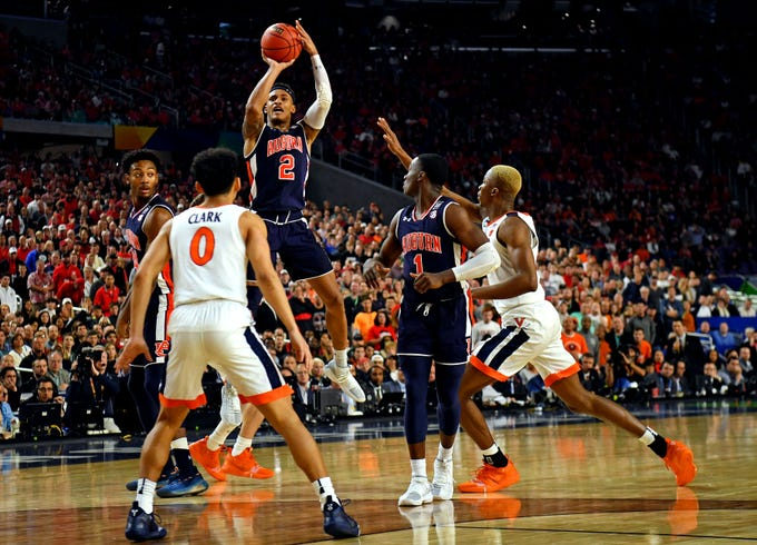 Apr 6, 2019; Minneapolis, MN, USA; Auburn Tigers guard Bryce Brown (2) shoots the ball against Virginia Cavaliers forward Mamadi Diakite (25) during the second half in the semifinals of the 2019 men's Final Four at US Bank Stadium. Mandatory Credit: Bob Donnan-USA TODAY Sports