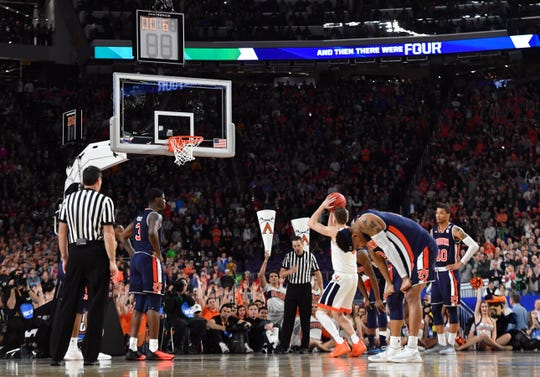 Apr 6, 2019; Minneapolis, MN, USA; Virginia Cavaliers guard Kyle Guy (5) takes a free throw in the second half against the Auburn Tigers in the semifinals of the 2019 men's Final Four at US Bank Stadium. Mandatory Credit: Robert Deutsch-USA TODAY Sports