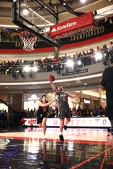 Tayler Persons hits a game-winning shot against Ethan Happ during the 3X3U tournament Sunday at Mall of America in Minneapolis
