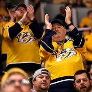 Fans cheer after Nashville Predators defenseman Dante Fabbro (57) scored against the Chicago Blackhawks during the second period at Bridgestone Arena in Nashville, Tenn., Saturday, April 6, 2019.