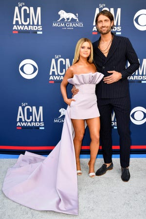 Maren Morris, left, and Ryan Heard walk the red carpet at the Academy of Country Music Awards in 2019.