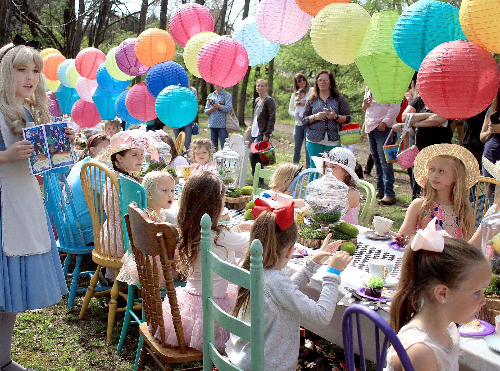 Alice in Wonderland reads the book to those in attendance at the Mad Hatter Tea Party at Rock Castle in Hendersonville, TN on Saturday, April 6, 2019.