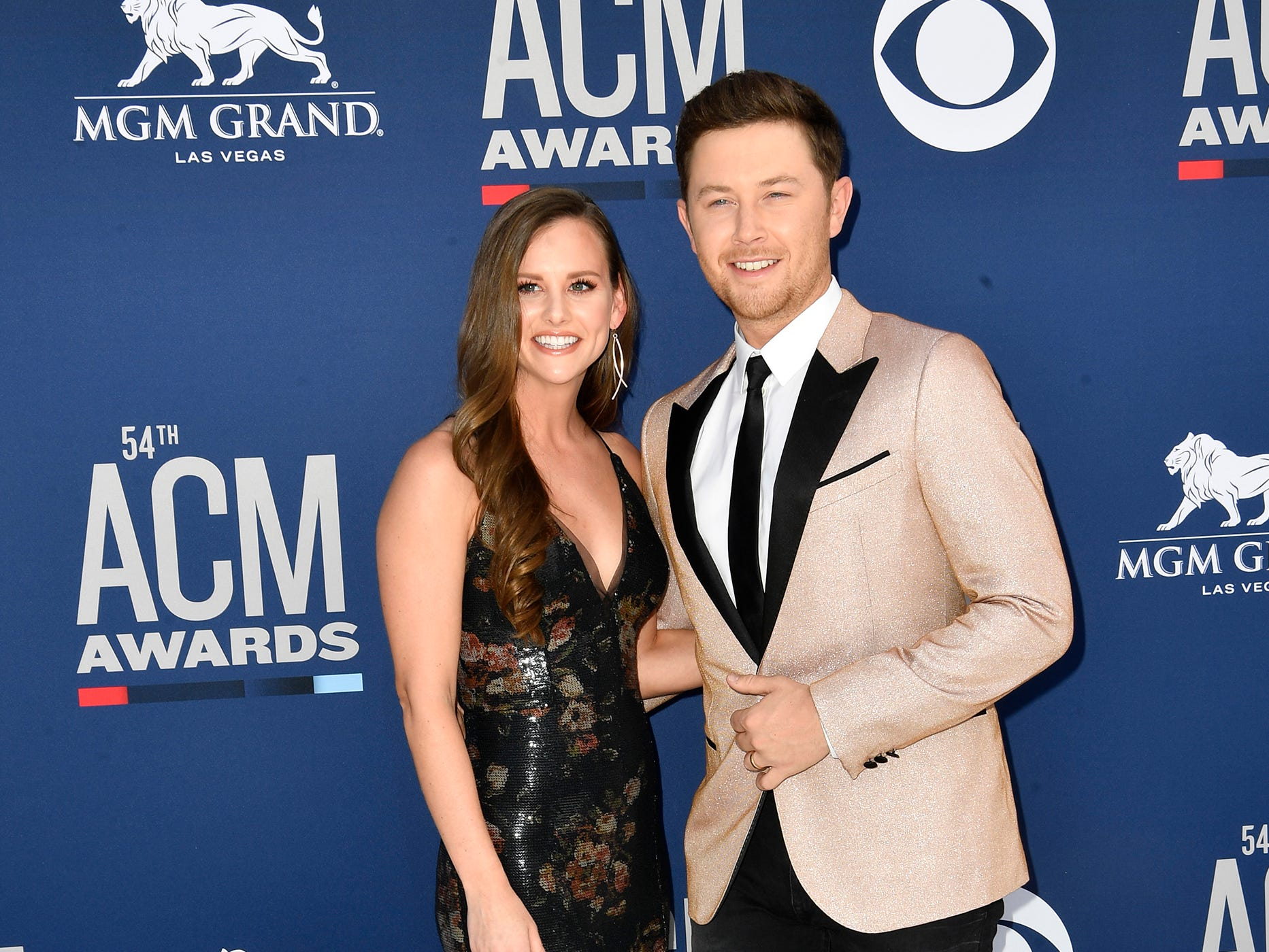 Scotty McCreery, right, and Gabi Dugal, walk the red carpet at the 54TH Academy of Country Music Awards Sunday, April 7, 2019, in Las Vegas, Nev.