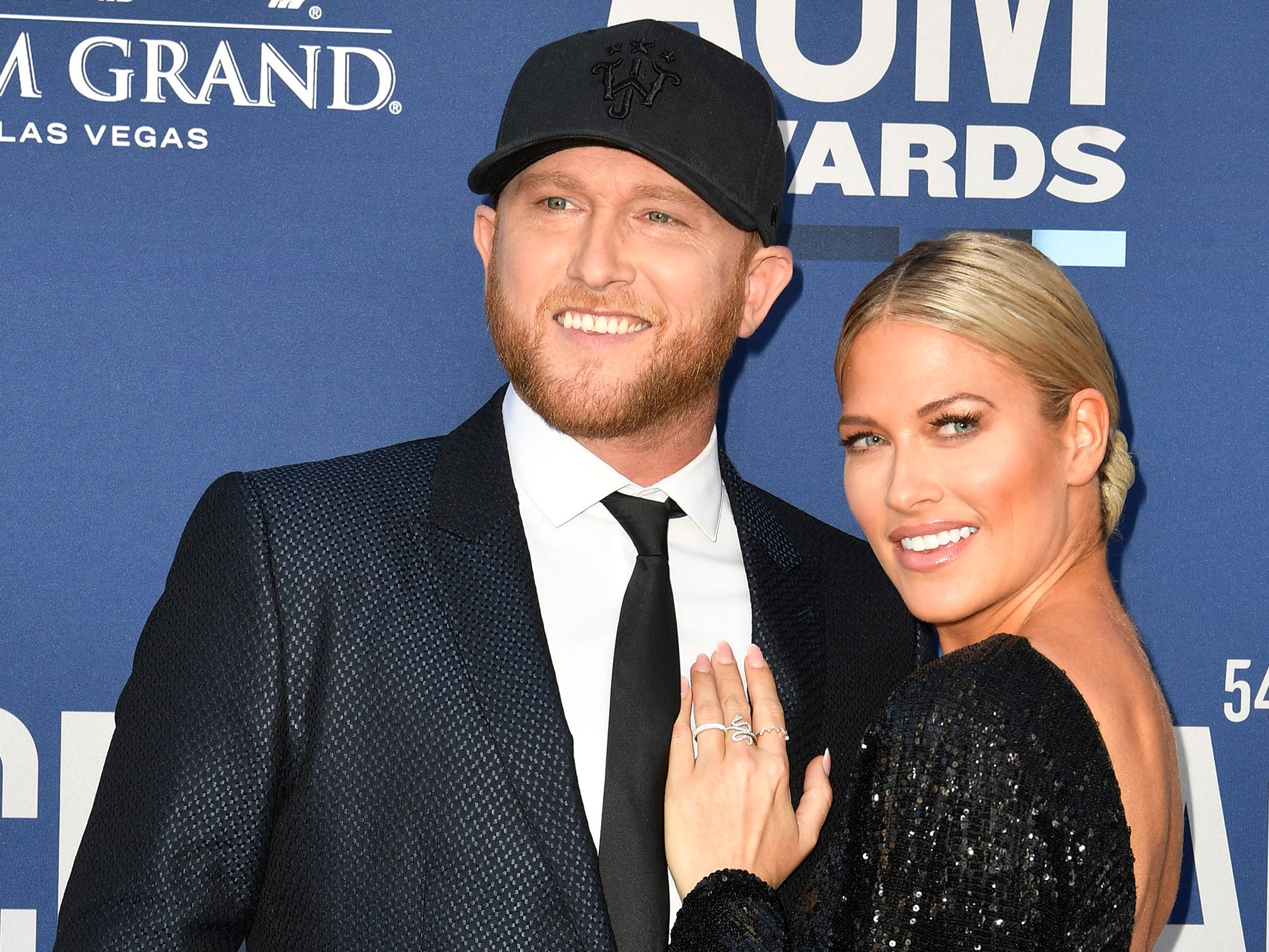 Cole Swindell, left, with Barbie Blank, walk the red carpet at the 54TH Academy of Country Music Awards Sunday, April 7, 2019, in Las Vegas, Nev.