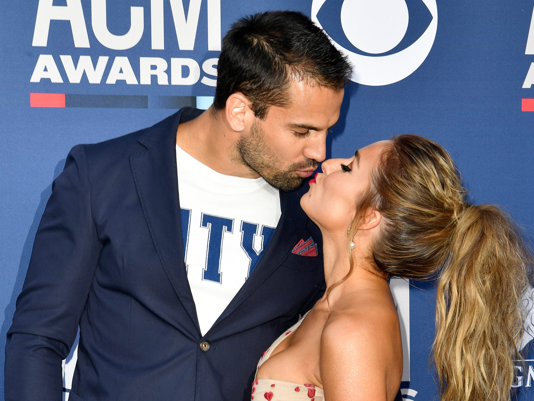 Jessie James Decker, right, with Eric Decker, walk the red carpet at the 54TH Academy of Country Music Awards Sunday, April 7, 2019, in Las Vegas, Nev.