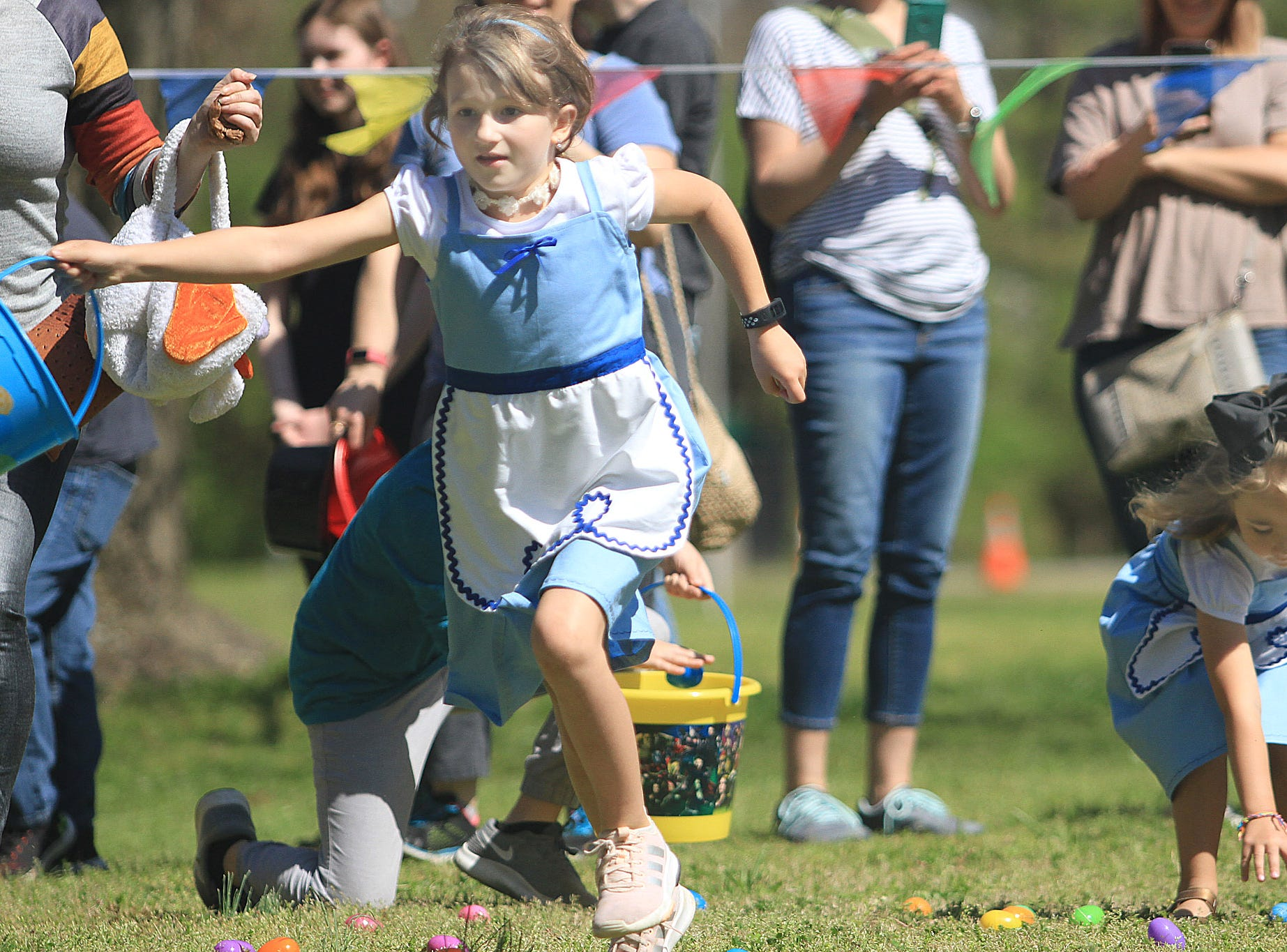 Piper Grigsby (7) busts out of the start of the Wonderland Egg Hunt at Rock Castle in Hendersonville, TN on Saturday, April 6, 2019.