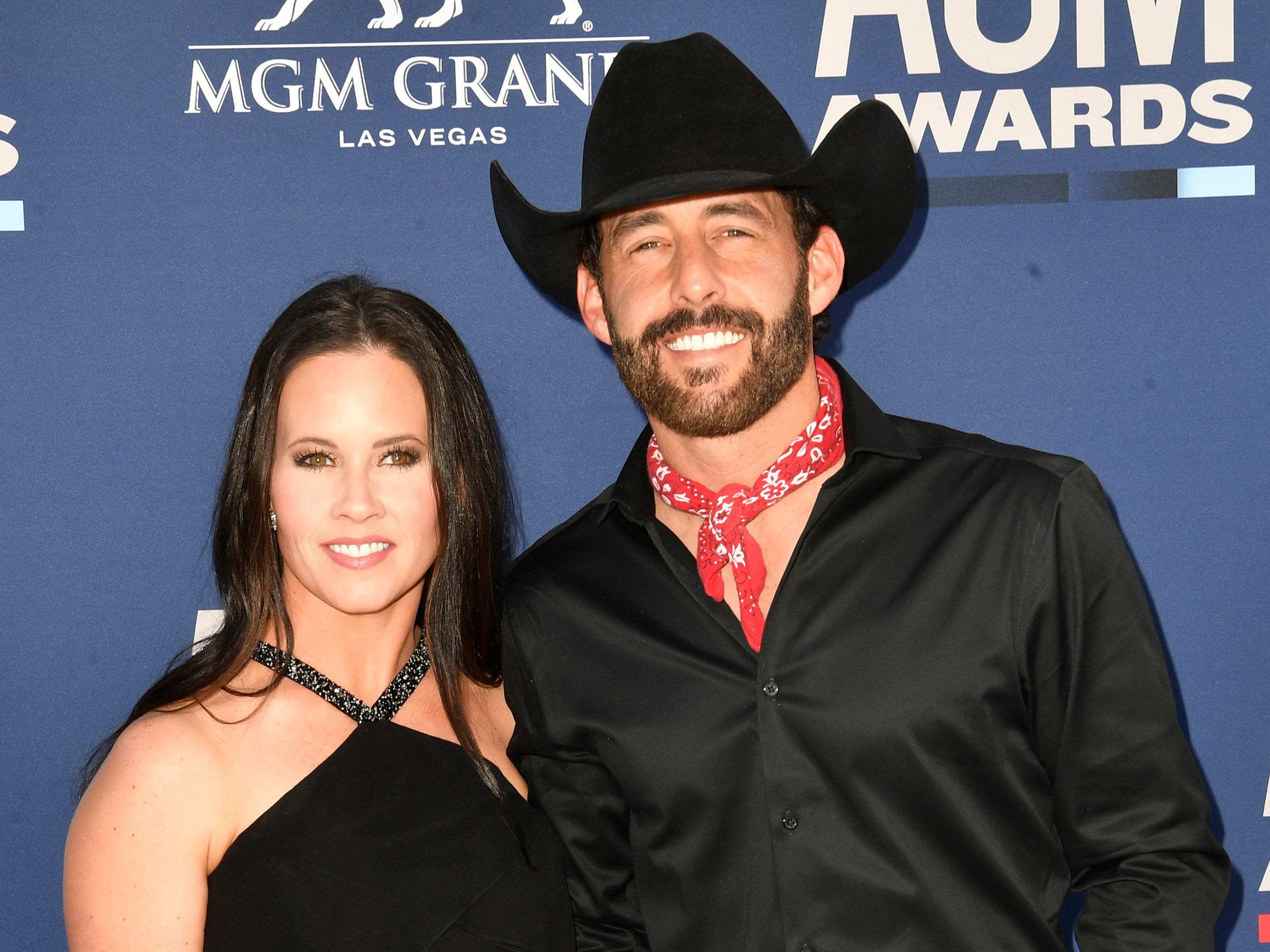 Aaron Watson, right, and his wife Kim Watson walk the red carpet at the 54TH Academy of Country Music Awards Sunday, April 7, 2019, in Las Vegas, Nev.