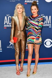 Madison Marlow, left, and Taylor Dye of Maddie & Tae, walk the red carpet at the 54TH Academy of Country Music Awards Sunday, April 7, 2019, in Las Vegas, Nev.