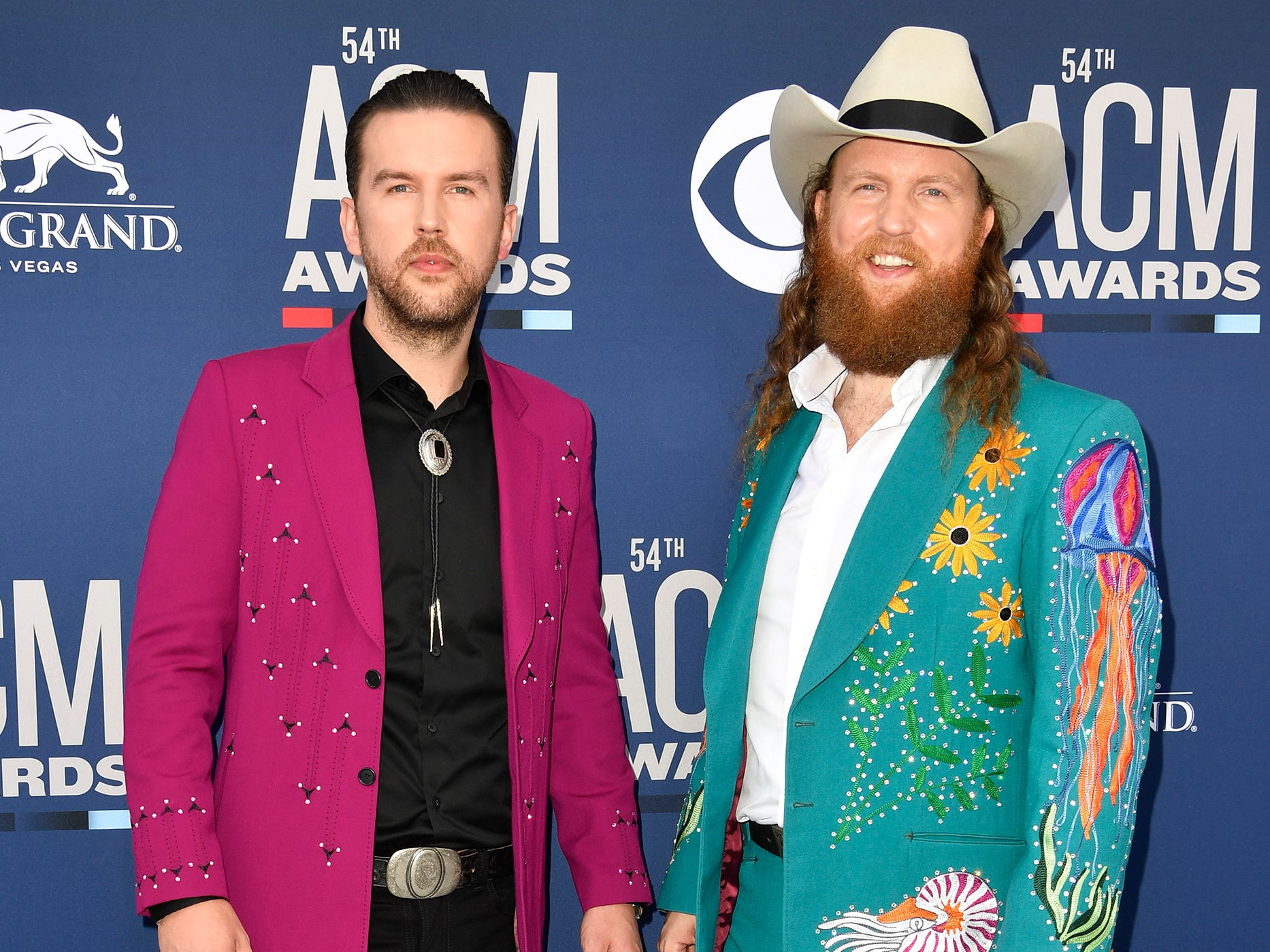 T.J. Osborne, left, and John Osborne of Brothers Osborne, walk the red carpet at the 54TH Academy of Country Music Awards Sunday, April 7, 2019, in Las Vegas, Nev.