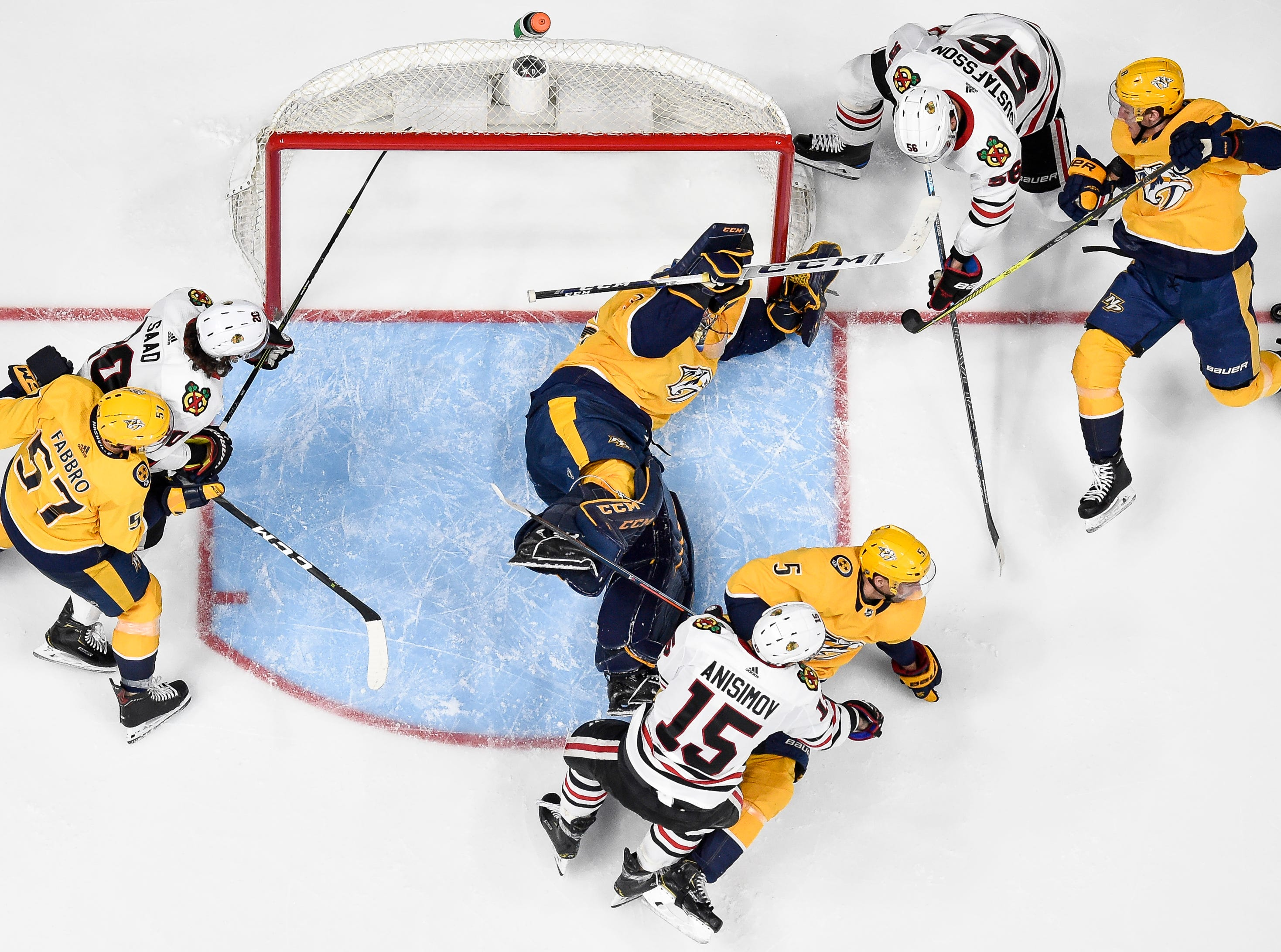 Nashville Predators goaltender Pekka Rinne (35) and center Kyle Turris (8) defend against Chicago Blackhawks defenseman Erik Gustafsson (56) during the third period at Bridgestone Arena in Nashville, Tenn., Saturday, April 6, 2019.