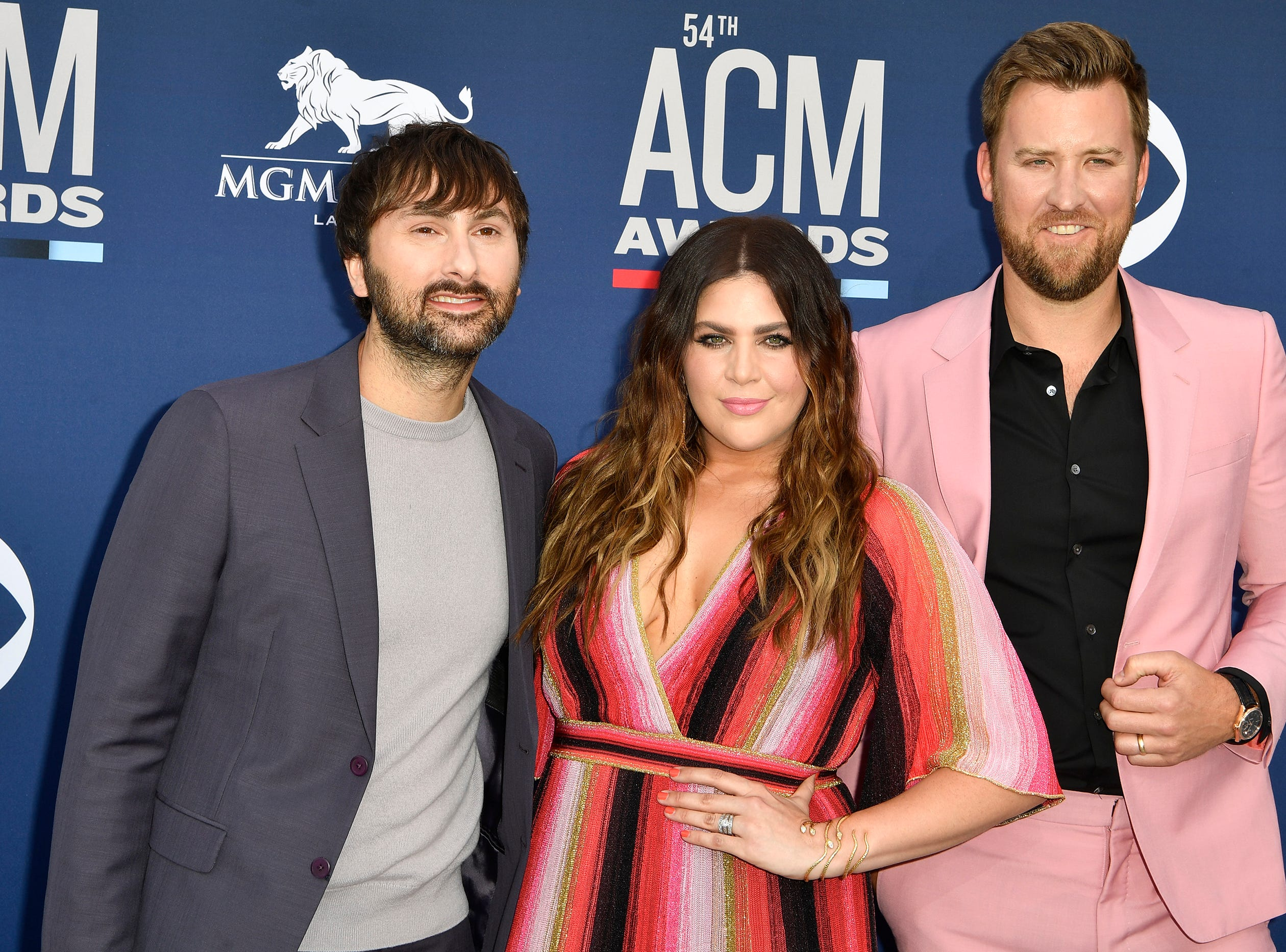 Dave Haywood, from left, Hillary Scott, and Charles Kelley of Lady Antebellum, walk the red carpet at the 54TH Academy of Country Music Awards Sunday, April 7, 2019, in Las Vegas, Nev.