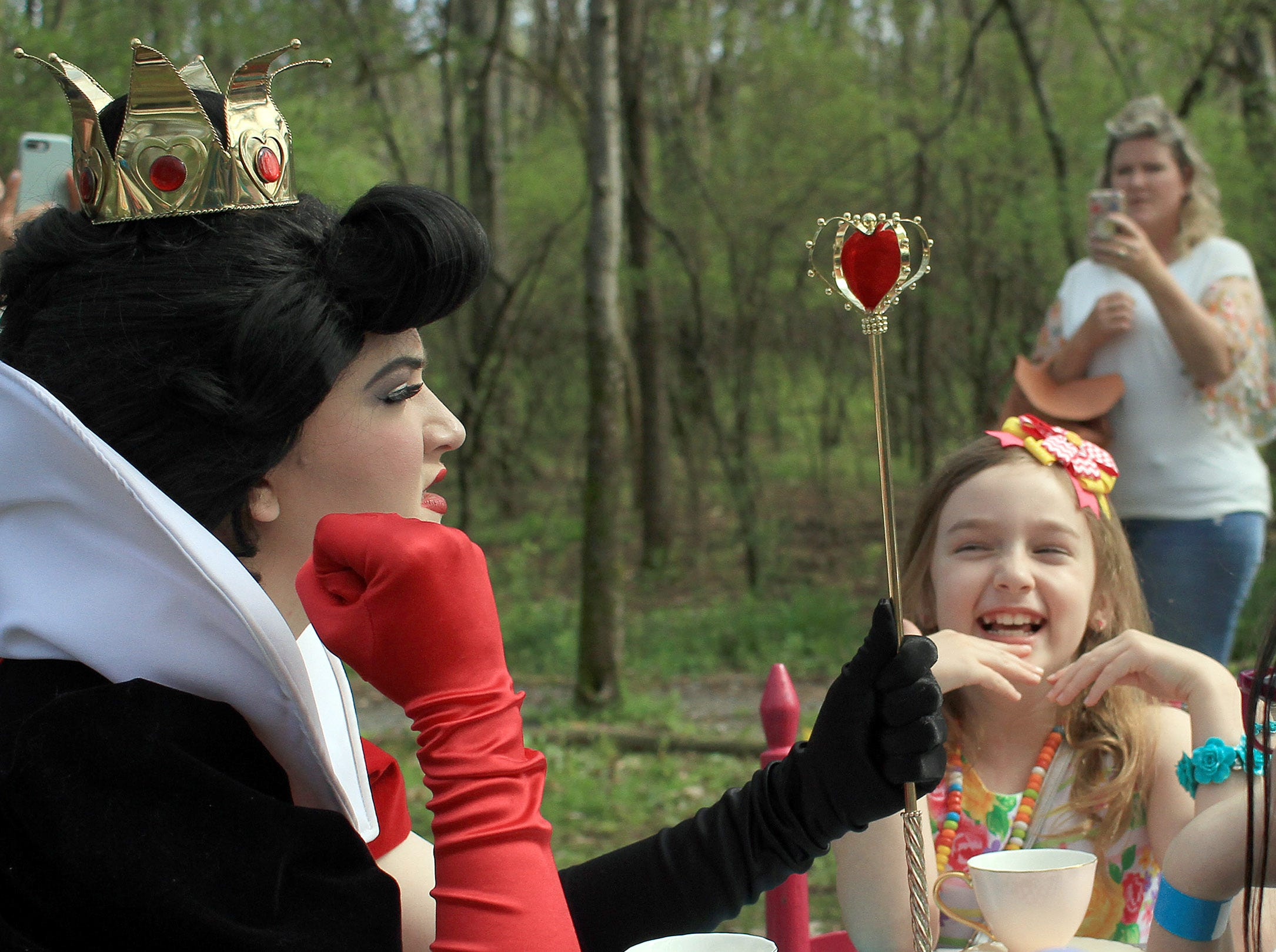 Landry Potter  (8) is amused by the Queen of Hearts at the tea party at Rock Castle in Hendersonville , TN on Saturday, April 6, 2019.