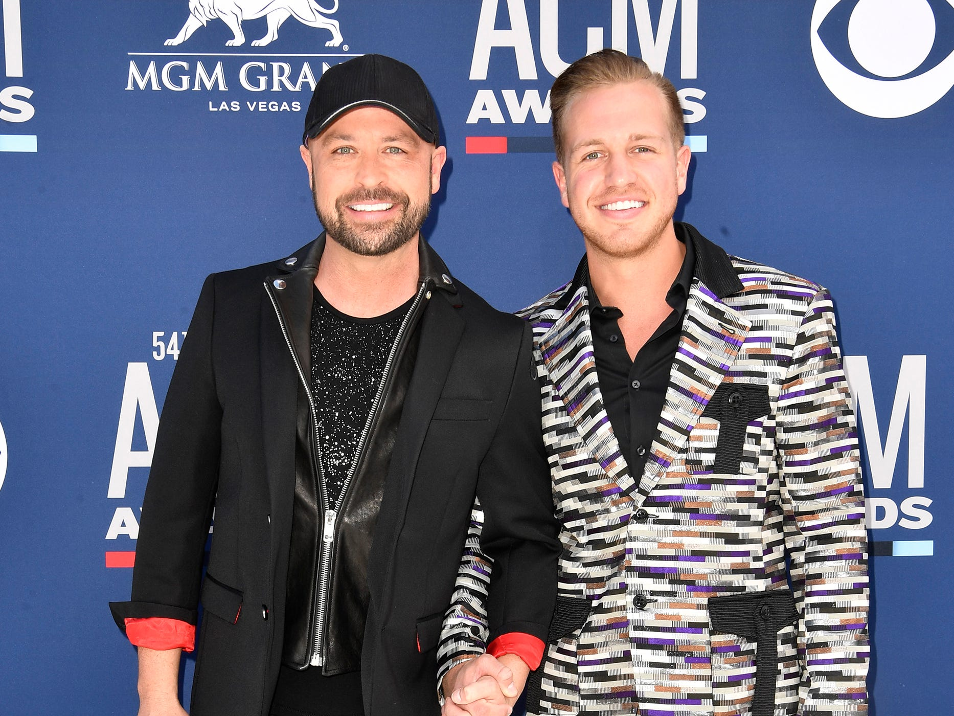 Cody Alan, left, and Michael Trea Smith, walk the red carpet at the 54TH Academy of Country Music Awards Sunday, April 7, 2019, in Las Vegas, Nev.