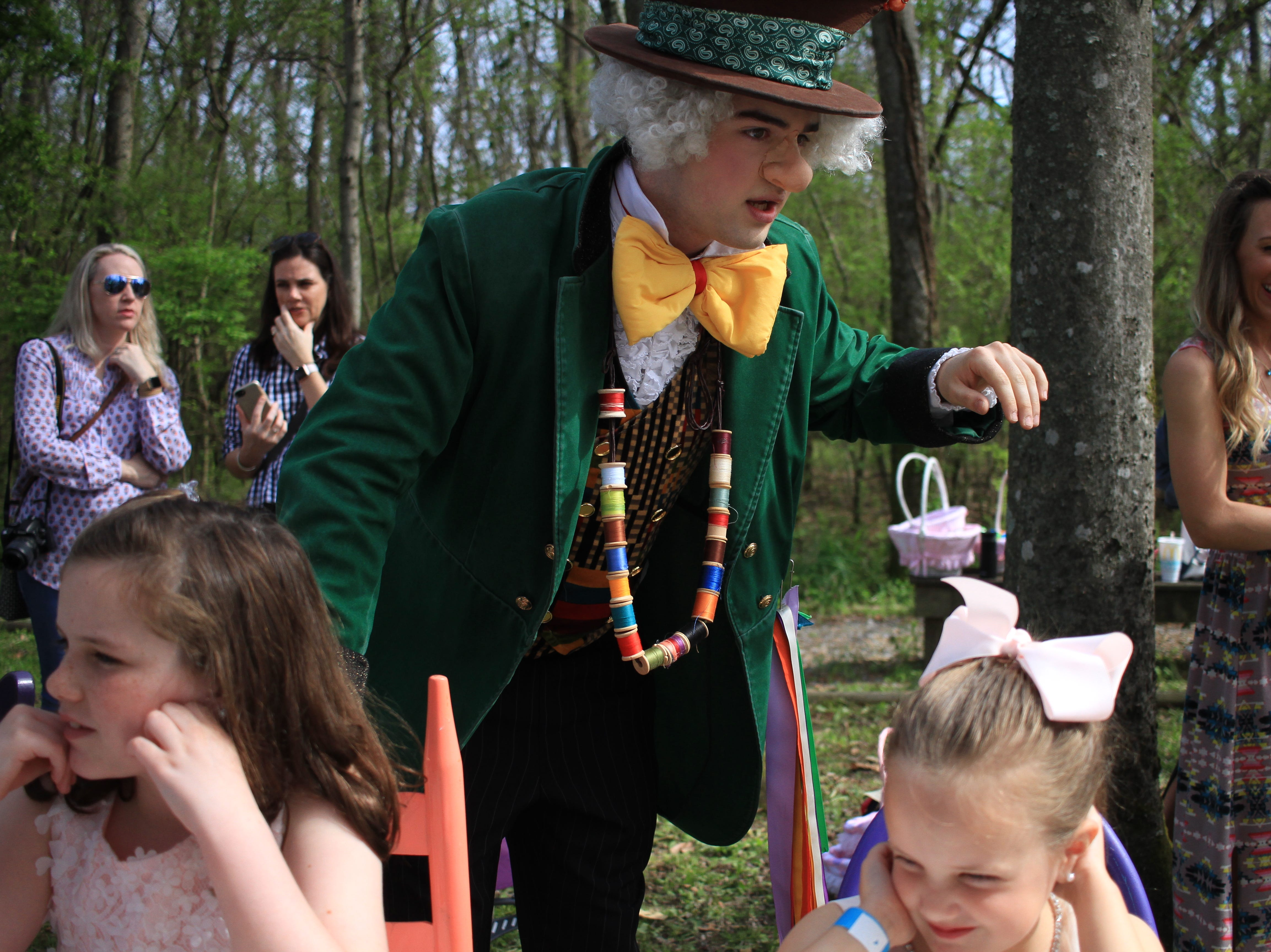 Guests enjoy the day at the Mad Hatter Tea Party in the Rock Castle Woodlands on Saturday, April 6, 2019.