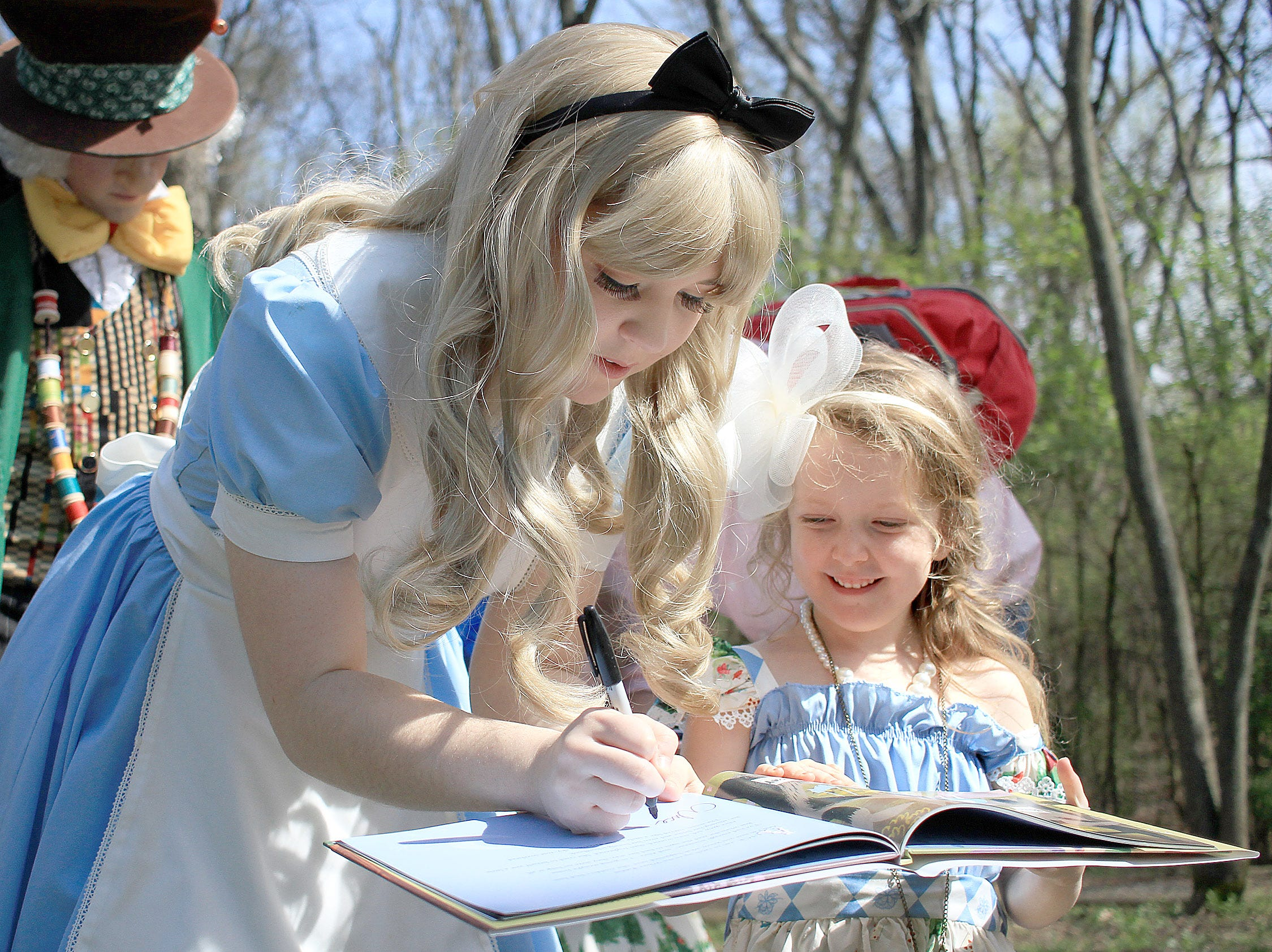 McKinley Passcarella (5) gets an autograph from Alice in Wonderland at Rock Castle in Hendersonville, TN on Saturday, April 6, 2019.