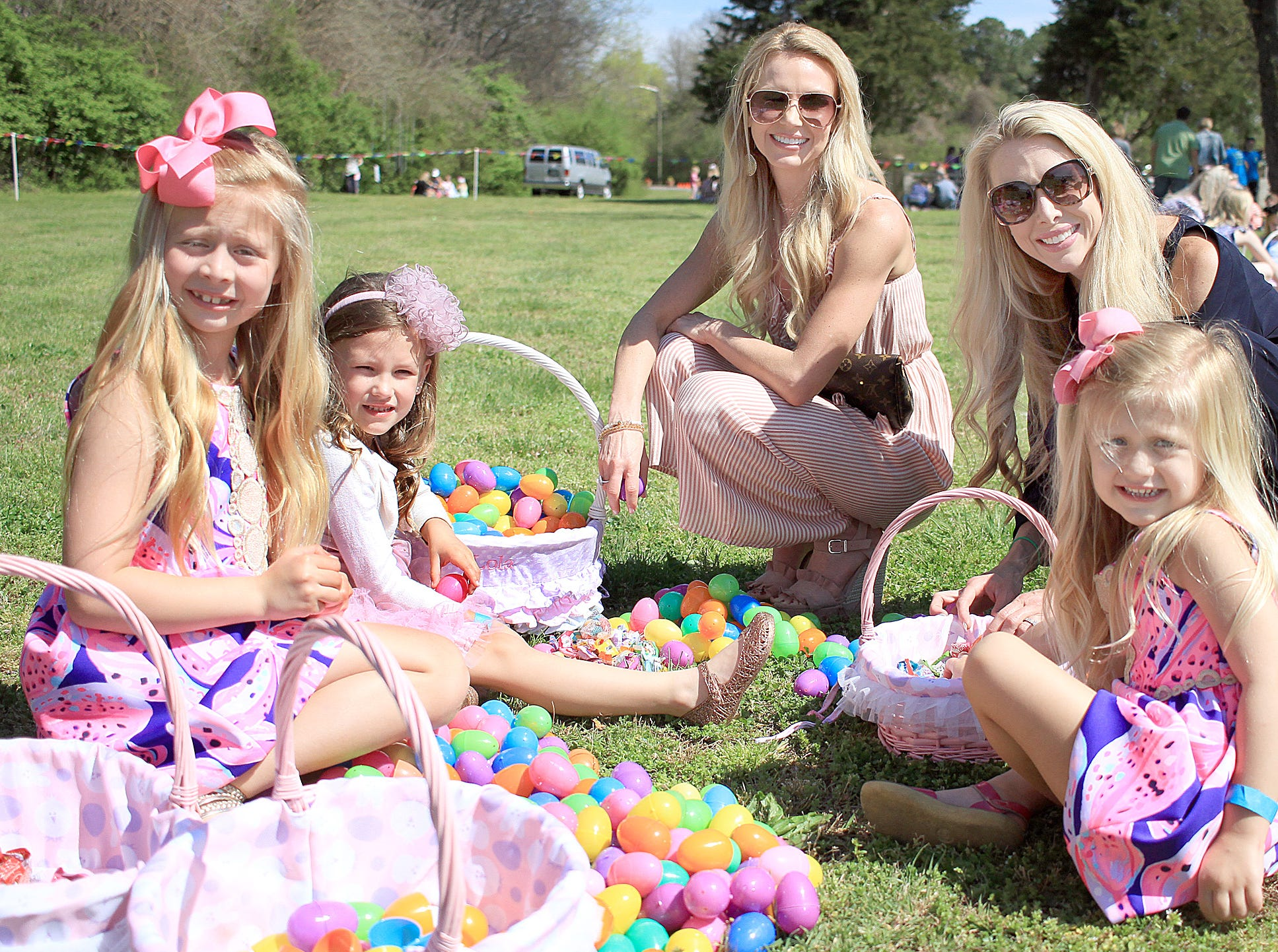 L-R Emma West, Lola Smith, Andi Smith, Jennifer West and Ella West count their eggs at Rock Castle in Hendersonville, TN on Saturday, April 6, 2019.