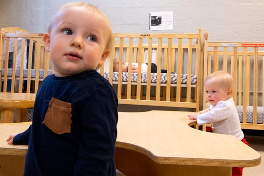 Wrenley Sunderlin (right), 13 months, uses the table for balance during day care at Fannie Battle Day Home Thursday, March 28, 2019, in Nashville, Tenn. East End Prep teachers struggled to find day care options and remain in their positions. As a result, administrators created the infant room for teachers' children at a lower cost and aligning with their schedules.