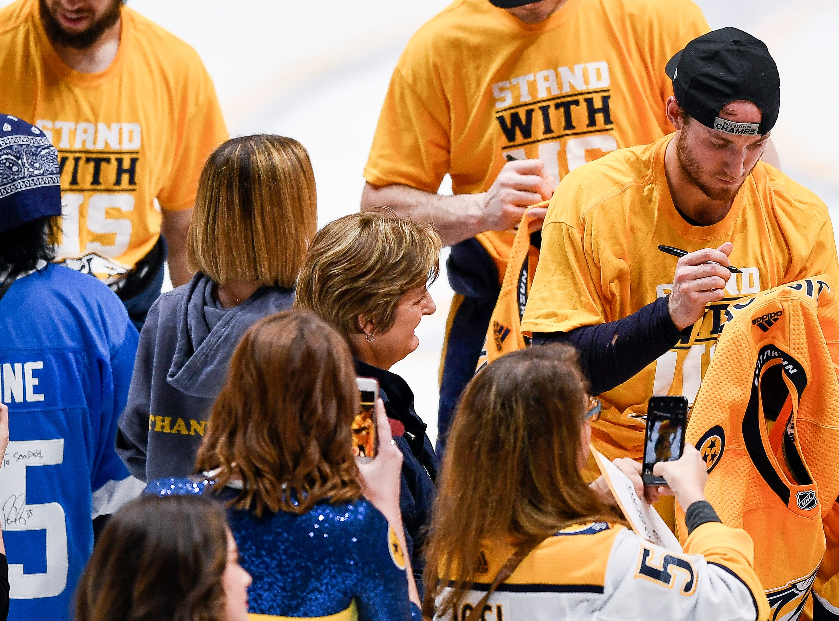 Nashville Predators center Colton Sissons (10) autographs his jersey after defeating the Chicago Blackhawks at Bridgestone Arena in Nashville, Tenn., Saturday, April 6, 2019.