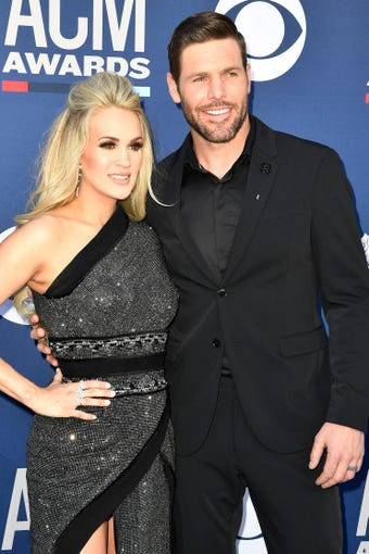 Carrie Underwood, left, with Mike Fisher, walk the red carpet at the 54TH Academy of Country Music Awards Sunday, April 7, 2019, in Las Vegas, Nev.