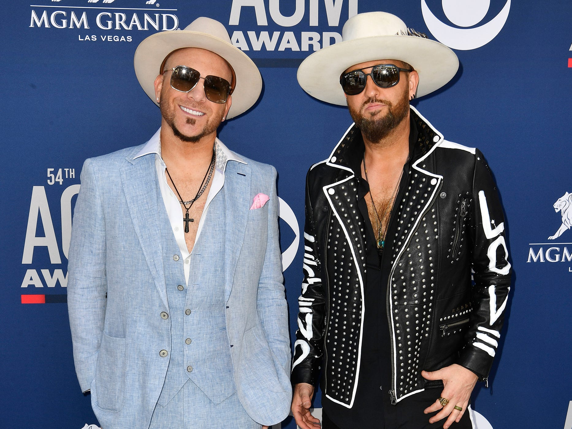 Chris Lucas, left, and Preston Brust of LOCASH, walk the red carpet at the 54TH Academy of Country Music Awards Sunday, April 7, 2019, in Las Vegas, Nev.