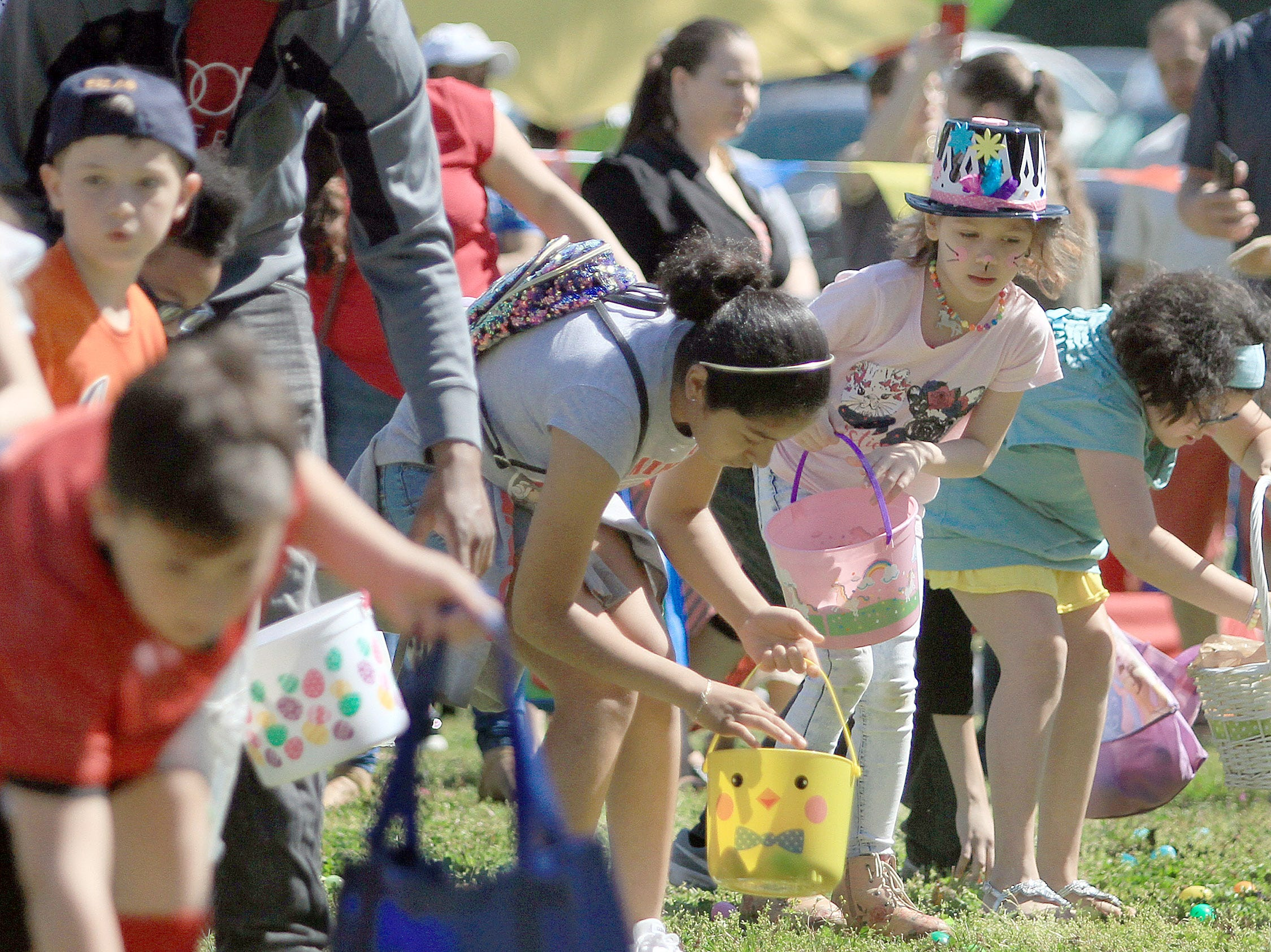 Kids grab as many eggs as they can at the egg hunt at Rock Castle in Hendersonville, TN on Saturday, April 6, 2019.