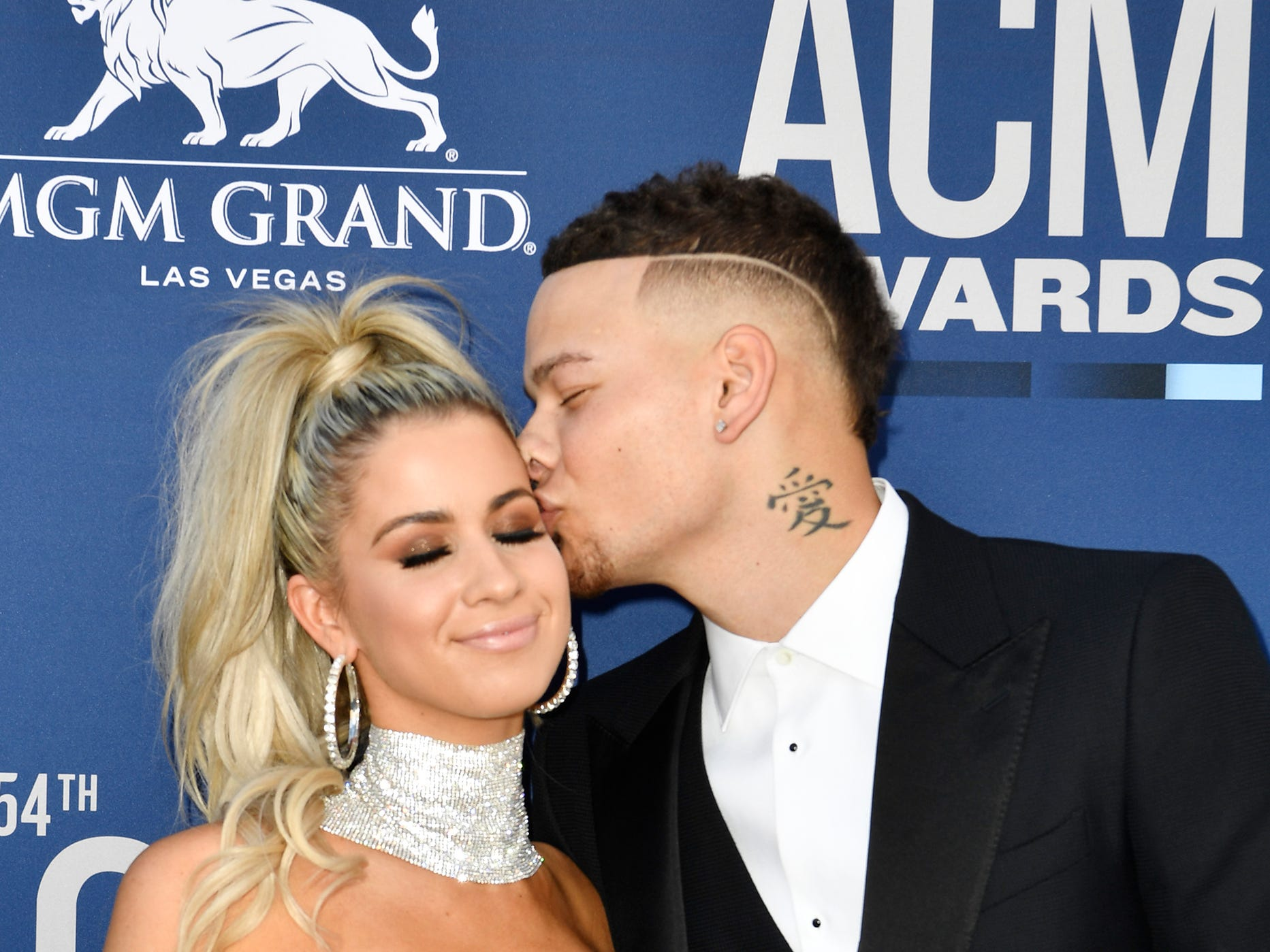 Kane Brown, right, and wife Katelyn Brown, walk the red carpet at the 54TH Academy of Country Music Awards Sunday, April 7, 2019, in Las Vegas, Nev.