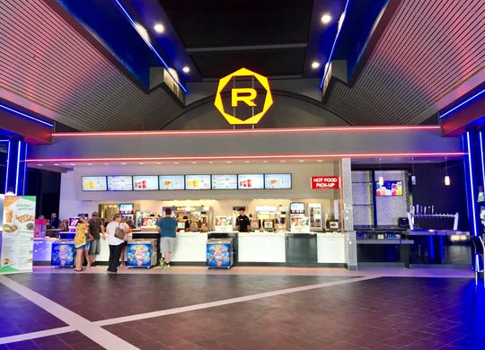 Regal Hollywood Naples reopened Sunday, April 7, 2019, with renovations that include a new look in the lobby with a bar area, right, eventually added to the cinema's concessions.
