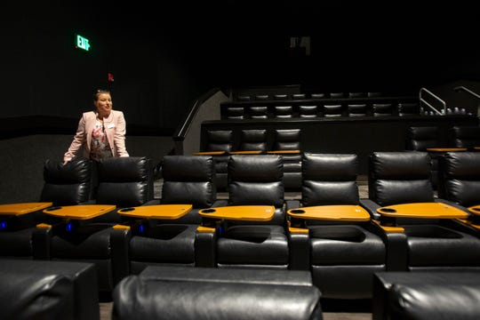 Liz Razilou, general manager at Hollywood 20 cinema, shows one of the theaters Sunday, April 7, 2019, in North Naples.