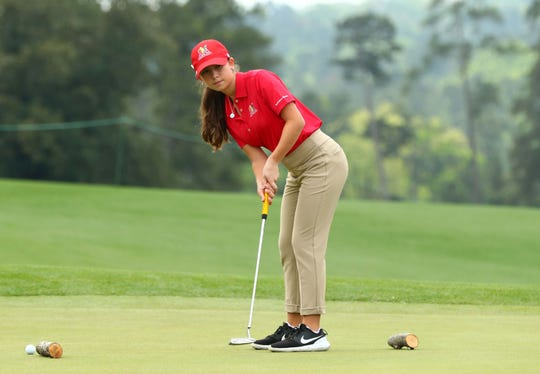 Talia Rodino of Fort Myers in the girls 14-15 age group, watches her putt during the finals of the Drive, Chip and Putt competition at Augusta National Golf Club on Sunday. Rodino finished 10th.