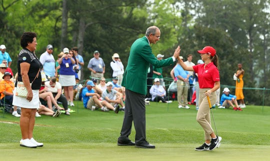 Hall of Fame golfer Nancy Lopez and Augusta National member Brian L. Roberts congratulate Talia Rodino of Fort Myers in the girls 14-15 age group during the finals of the Drive, Chip and Putt competition at Augusta National Golf Club on Sunday. Rodino finished 10th.