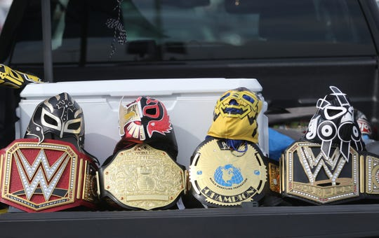Wrestling fans displayed their belts at the MetLife Stadium parking lot before WrestleMania. Sunday, April, 7, 2019