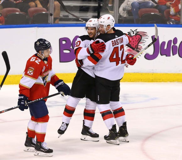 Apr 6, 2019; Sunrise, FL, USA; New Jersey Devils right wing Nathan Bastian (42) celebrates his goal with center Blake Coleman (20) as Florida Panthers center Denis Malgin (62) looks on in the second period at BB&T Center.