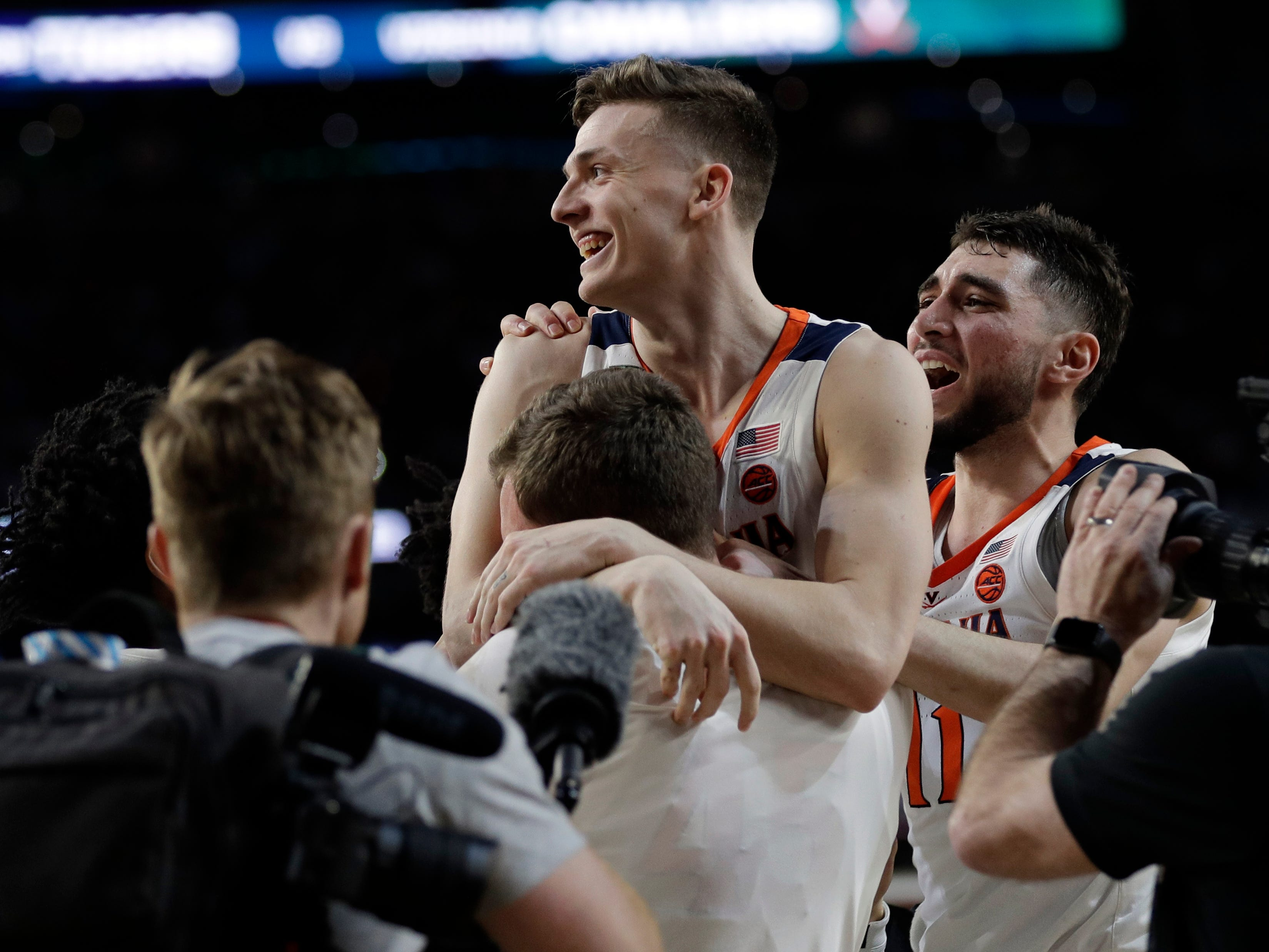 Virginia's Kyle Guy celebrates after defeating Auburn 63-62 in the semifinals of the Final Four NCAA college basketball tournament, Saturday, April 6, 2019, in Minneapolis.