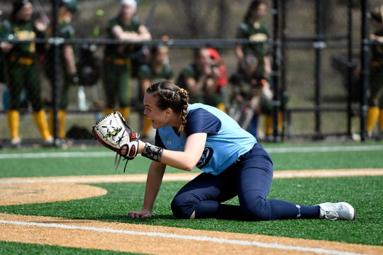 Immaculate Heart Academy pitcher Ryleigh White holds up the ball after making a diving catch. IHA defeats Morris Knolls 8-5 to win the first-ever NFCA New Jersey Leadoff Classic on Sunday, April 7, 2019, in Newark. This first Leadoff Classic is in honor of Anthony LaRezza, the former Immaculate Heart Academy coach who passed away in February 2016 after battling cancer.