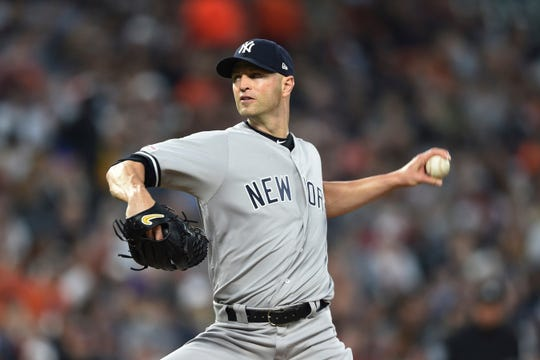 New York Yankees pitcher J.A. Happ throws to a Baltimore Orioles batter during the first inning of a baseball game Saturday, April 6, 2019, in Baltimore.