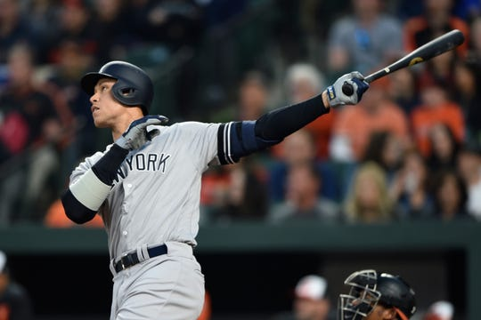 New York Yankees' Aaron Judge follows through on a solo home run against the Baltimore Orioles during the first inning of a baseball game Saturday, April 6, 2019, in Baltimore.