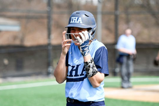 Immaculate Heart Academy's Mia Recenello smiles after her solo home run against Morris Knolls. IHA defeats Morris Knolls 8-5 to win the first-ever NFCA New Jersey Leadoff Classic on Sunday, April 7, 2019, in Newark. This first Leadoff Classic is in honor of Anthony LaRezza, the former Immaculate Heart Academy coach who passed away in February 2016 after battling cancer.